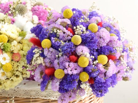 Photo for Multiple dried flowers tied with bouquets, put in the basket. - Royalty Free Image