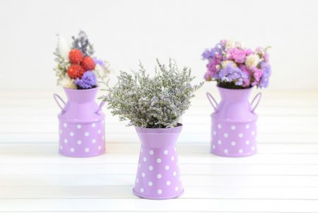 A small bunch of caspia dried flowers put into a c...