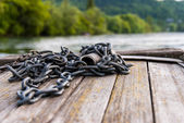 Chain over the planks of a river boat