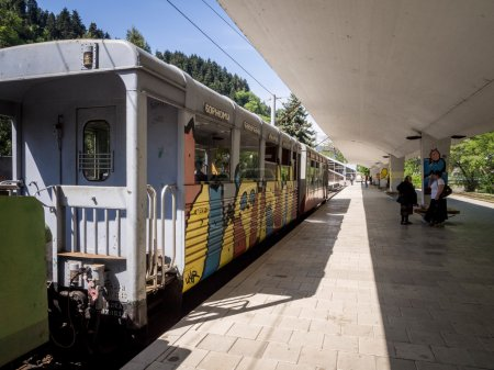 """BORJOMI, GEORGIA - MAY 06: """"Kukushka train in Borjomi on May 06, 2013. The train goes between Borjomi-Bakuriani was built by the Romanovs and it serves tourists and the fans of skiing since 1902"""