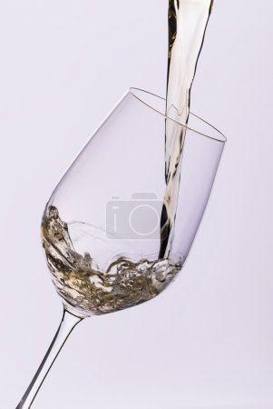 Photo for White wine pouring into glass closeup isolated - Royalty Free Image