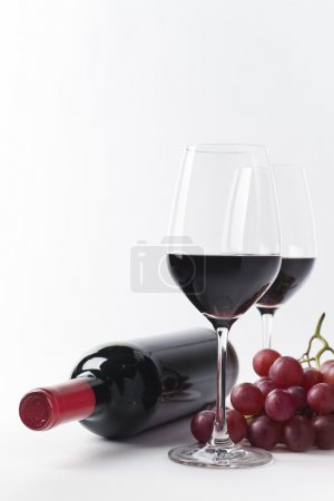 Simple red wine bottle, glasses and grapes