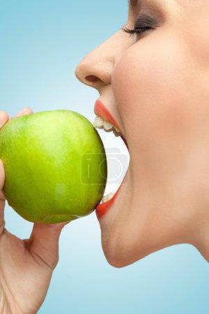 Biting apple.