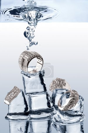 Photo for A view of jewelery being dropped on ice cubes underwater - Royalty Free Image
