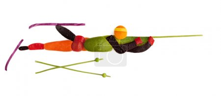 Fruits and vegetables in the shape of a shooting b...