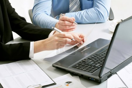 Business partners hands over papers