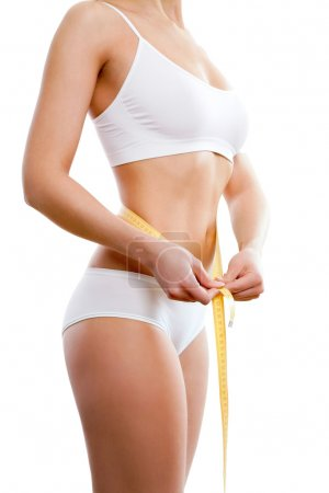 Photo for Beautiful sporty woman body with yellow measure on white background - Royalty Free Image