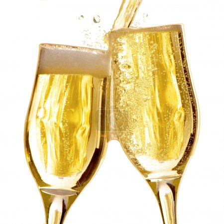 Photo for Pair of champagne flutes making a toast. - Royalty Free Image