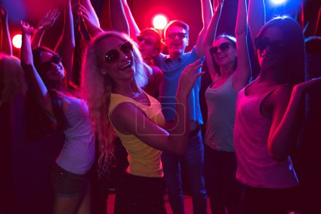 Photo for Young people having fun dancing in a nightclub - Royalty Free Image