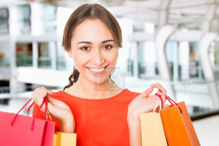 Photo for Beautiful young woman with shopping bags in a supermarket - Royalty Free Image