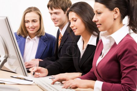 Photo for Four businesspeople work in team - Royalty Free Image