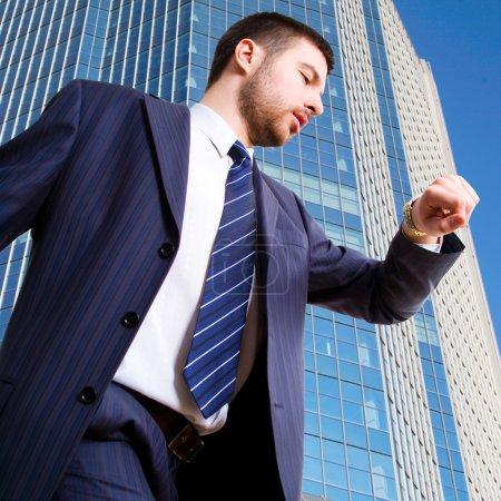 Businessman looking at wrist watch