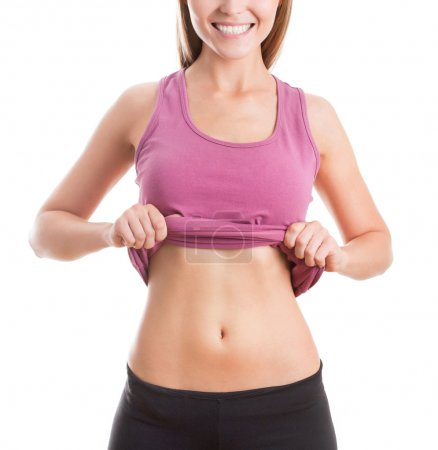 Photo for Happy fitness woman shows her belly - Royalty Free Image