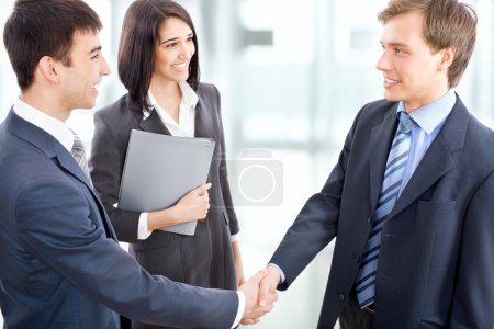 Photo for Business people shaking hands in modern office - Royalty Free Image