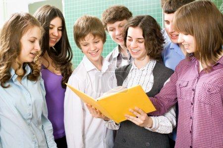 Students read textbook