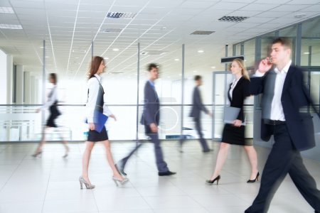 Business people walking in corridor
