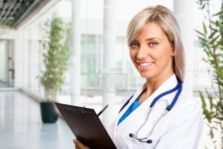 Photo for Female doctor at the holl by modern hospital - Royalty Free Image