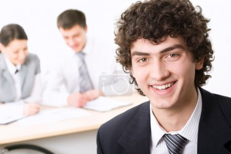 Photo for Young successful businessman and its team - Royalty Free Image