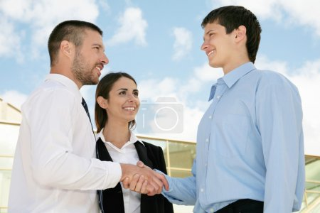 Businesspeople shake hands