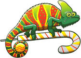 Exotic chameleon exhibiting a Christmas camouflage staring at you in a dubious attitude and walking gripped to a candy cane while holding a bauble with its prehensile tail