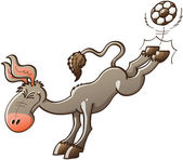 Excited gray donkey kicking a soccer ball