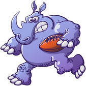 Strong scaring and courageous rhinoceros running in a very aggressive way while holding a rugby ball