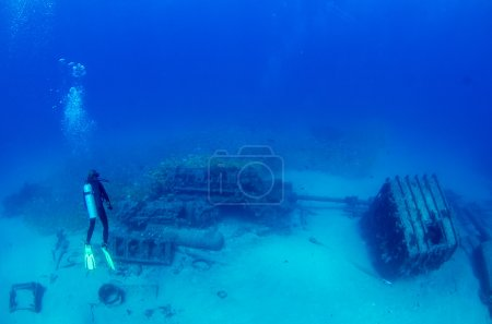 Divers underwater shipwreck