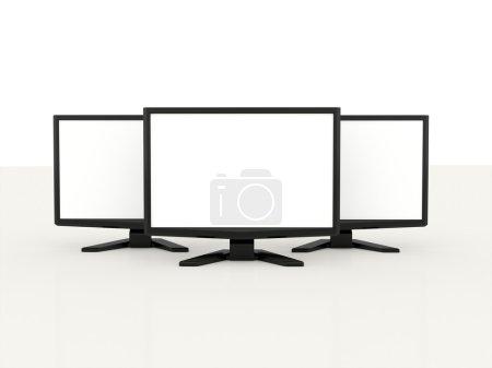 Photo pour Trois moniteurs LCD avec écran blanc sur fond blanc - image libre de droit