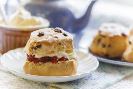 Traditional afternoon tea with scones, jam and cream