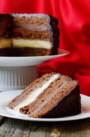 Photo for Chocolate cake with red cloth on a wood background - Royalty Free Image