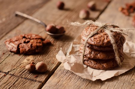 Photo for Chocolate chip cookies with walnuts on a wood background. toning. focus on the second cookies from below - Royalty Free Image