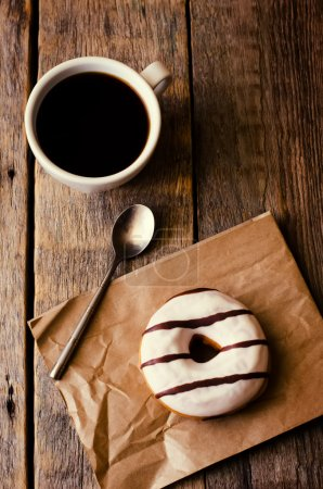 Photo for Donuts and coffee on the dark wood background toning - Royalty Free Image