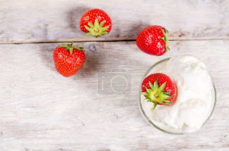 Photo for Ice cream with strawberry on a white wood background. toning.selective focus on  strawberry on the ice cream - Royalty Free Image
