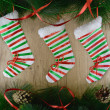 Colorful Christmas socks with conifer and baubles ...