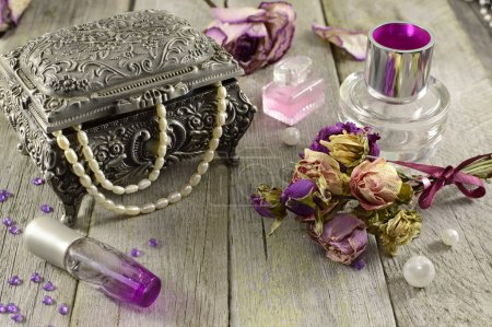 Vintage still life with lilac fragrances