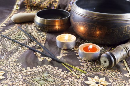 Photo for Asian tibet singing bowls and candles - Royalty Free Image