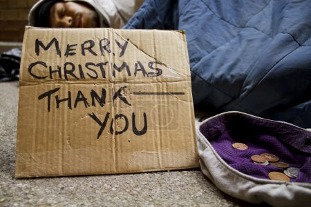 Homeless man sleeping on the streets at Christmas