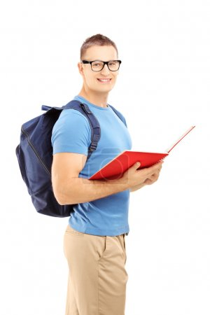 Student with backpack reading book