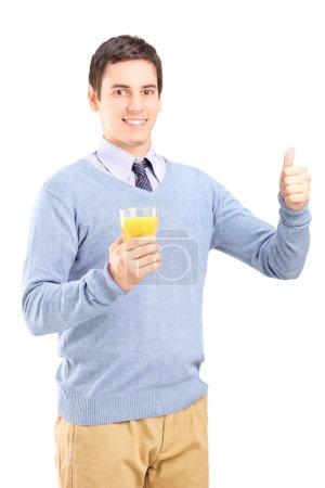 Man holding an orange juice