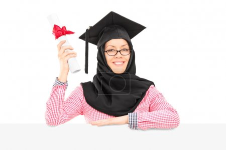 Islamic student holding diploma