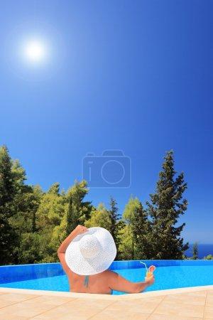 Female relaxing in swimming pool