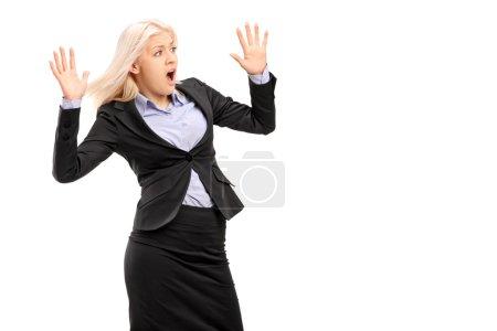 Businesswoman gesturing fear