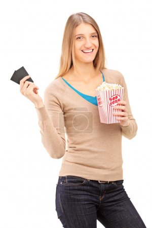 Girl holding tickets and popcorn