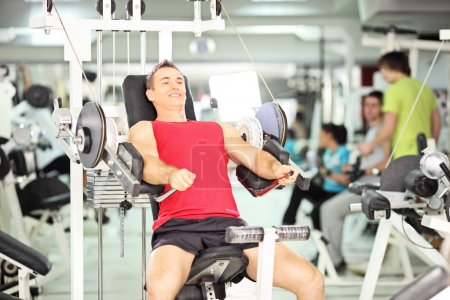 Man exercising in fitness club
