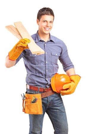 Carpenter holding helmet