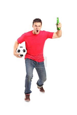 Euphoric fan holding beer bottle