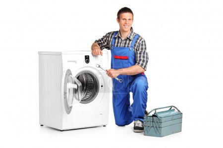 Repairman next to washing machine