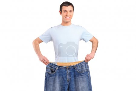Weight loss male showing old jeans