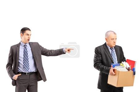 Angry boss firing an employee