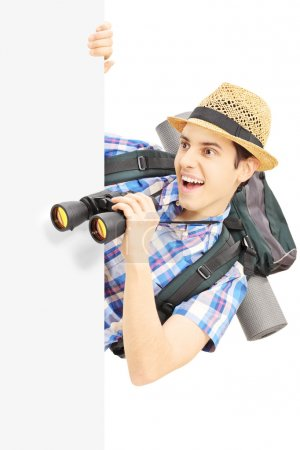 Male tourist looking through binocular